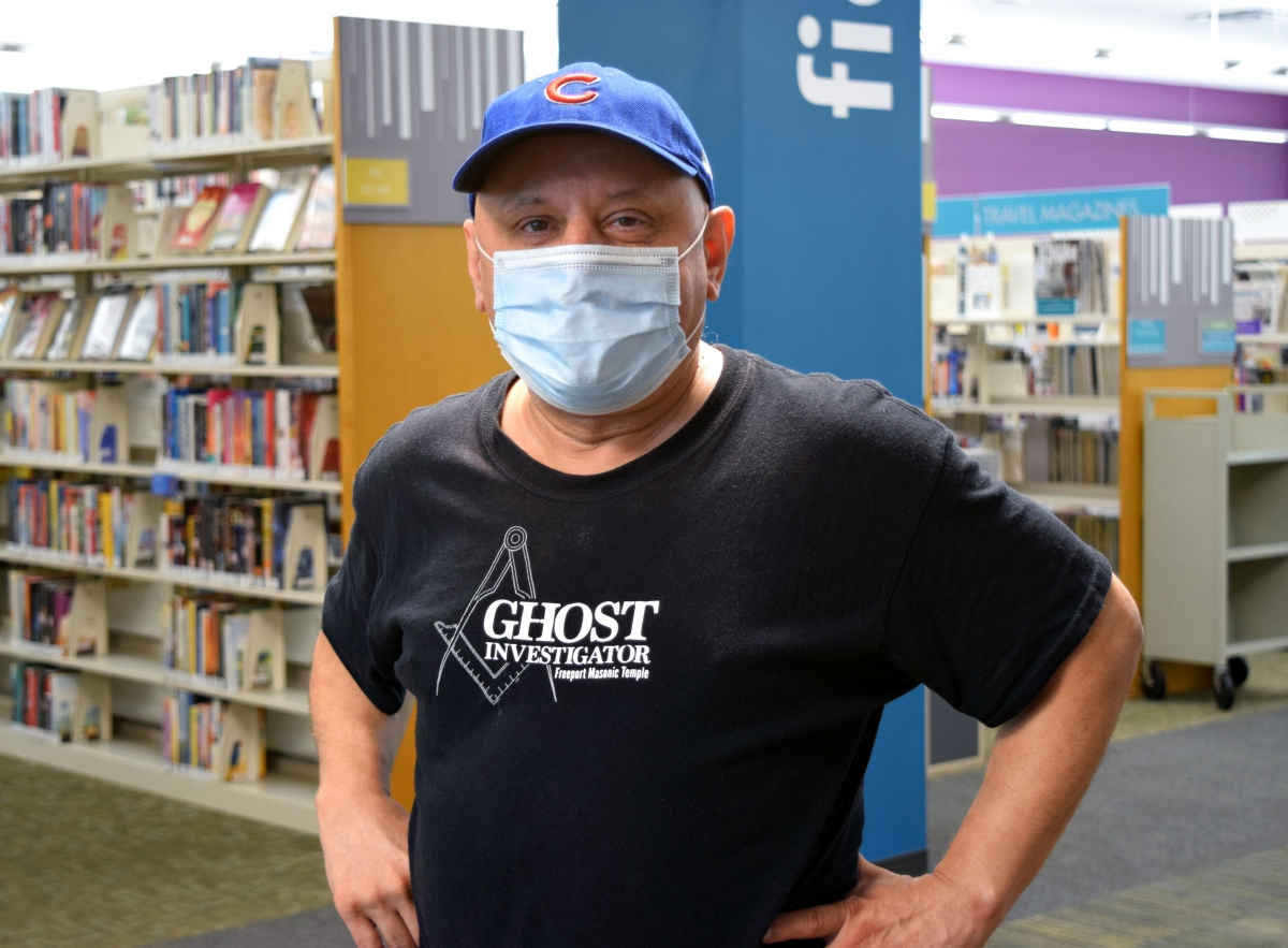 Tony Szabelski poses for a photo at the library.